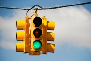image of a traffic light showing green for go to illustrate how you can convince a client to say yes to being in your marketing case study