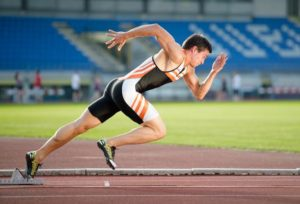 image of a running sprinter bursting from the starting blocks as a visual analogy for the Quickest, Simplest Way to Rank High on Google